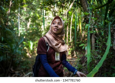 Langkawi, Malaysia - February 24, 2019: Local guide explaining the naturure surrounding the Sky Cab area