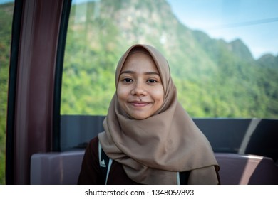 Langkawi, Malaysia - February 24, 2019: Local guide explaining the nature surrounding the Sky Cab area