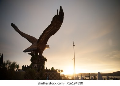 LANGKAWI , MALAYSIA - JULY 22 , 2016 :Silhouette of the reddish-brown eagle at Dataran Lang that was built as an emblem of the island. Situated on Eagle Square in Kuah town Langkawi Malaysia.