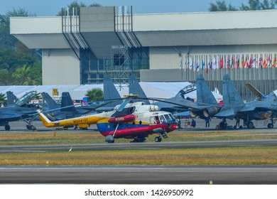 Langkawi, Malaysia - Mar 30, 2019. Mil Mi-17 Hip helicopter of Malaysia Fire and Rescue Services (M994-02) docking at Langkawi Airport (LGK).