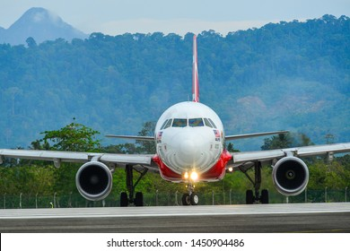 Langkawi, Malaysia - Mar 30, 2019. 9M-AHY AirAsia Airbus A320 (BIG Duty Free Livery) taxiing on runway of Langkawi Airport (LGK).