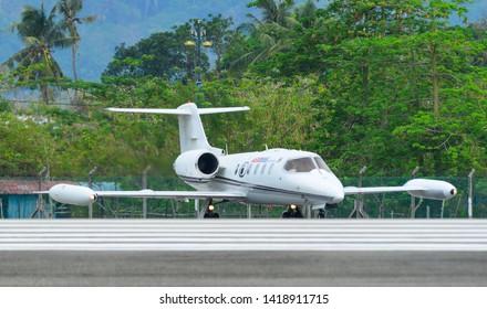Langkawi, Malaysia - Mar 31, 2019. M102-01 Gates Learjet 35A Royal Malaysia Air Force (RMAF) taxiing on runway of Langkawi International Airport (LGK).