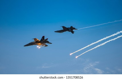 LANGKAWI, MALAYSIA : MARCH 27, 2019 : Malaysian airforce F18 Hornet fighter planes shoot flares during airshow at the LIMA exhibition, Langkawi, Malaysia