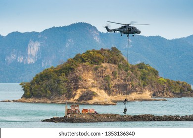 LANGKAWI, MALAYSIA : MARCH 28, 2019 : Malaysian Navy Super Lynx helicopter stages an airlift rescue operation at the LIMA exhibition, Langkawi, Malaysia