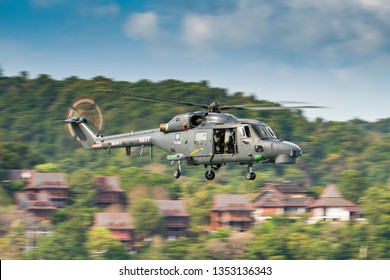 LANGKAWI, MALAYSIA : MARCH 28, 2019 : Malaysian Navy Super Lynx helicopter en route to a staged rescue operation at the LIMA exhibition, Langkawi, Malaysia
