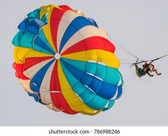 Langkawi, Malaysia - October 10 2017: Parasailing Safety, Asian Tourist Accompanied by Guide