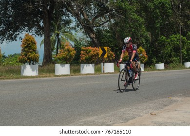 LANGKAWI, MALAYSIA-november 11: Sportsman rides a bike during the IRONMAN LANGKAWI triathlon on November  11, 2017 near Black Sand Beach, Langkawi Island, Malaysia.