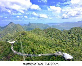 Langkawi Sky Bridge is a 125-metre curved pedestrian cable-stayed bridge in Malaysia and located 660 metres above sea level at the peak of Gunung Mat Cincang on Pulau Langkawi,Kedah.