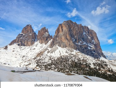 The Langkofel Group from the Sella pass in the late spring day, Dolomites, Italy.
