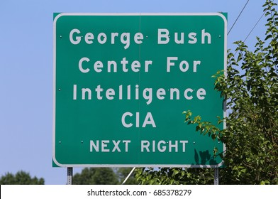 LANGLEY, VA - JULY 19: A road sign pointing the way to the CIA Headquarters complex in Langley, VA on July 19, 2017. The George Bush Center for Intelligence is the headquarters of the CIA.