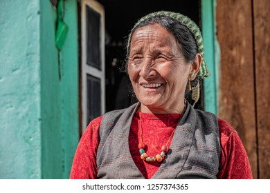 LANGTANG, NEPAL- NOVEMBER 08, 2018: Beautiful older nepalese woman from Langtang valley with wrinkled face posing for the camera.