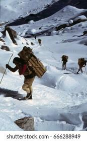 LANGTANG, NEPAL - OCT 15, 1986 -Porters near Ganja La pass after leaving Langtang Valley, Himalayas, Nepal, Asia