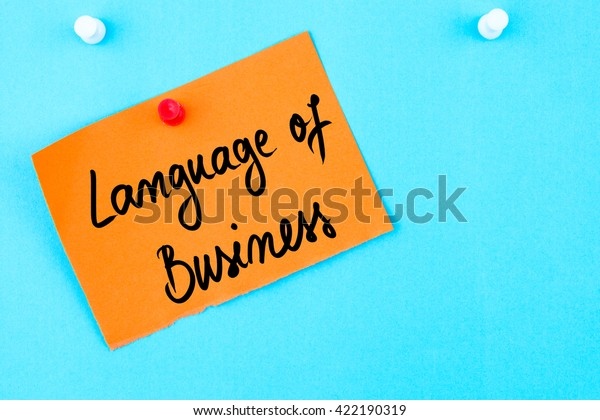 Language Of Business written on orange paper note pinned on cork board with white thumbtack, copy space available