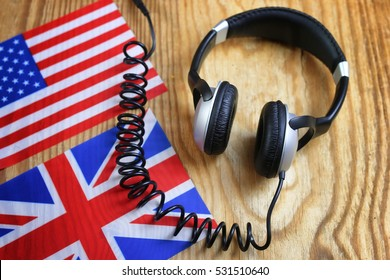 language course headphone and flag on wooden table