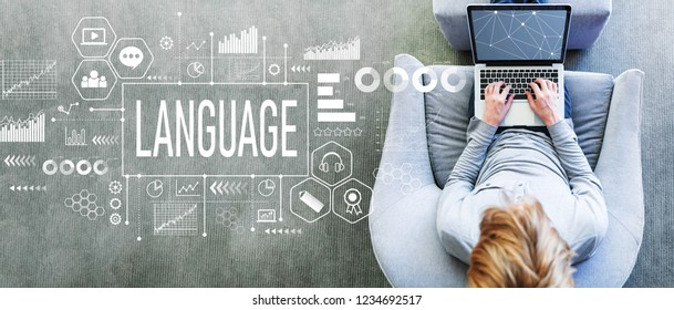Language with man using a laptop in a modern gray chair