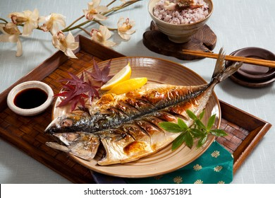 Language in Photo : good fortune mackerel grilled food.