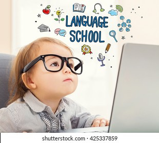 Language school concept with toddler girl using her laptop