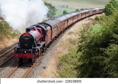 LANGWATHBY, ENGLAND - AUGUST 17: Preserved steam locomotive Galatea heads the Waverley south of Langwathby, England on August 17, 2014, on the Settle to Carlisle railway.