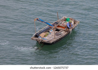 Lanh Ha Bay, Hai Phong, Vietnam - 12/23/2018: Fishermen live on the waters of Lanh Ha bay with its limestone karsts often covered with lush green vegetation.