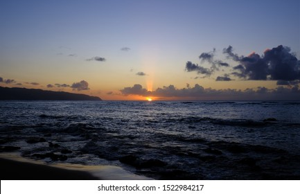 Laniakea Beach sunset, North Shore, Haleiwa, Oahu, Hawaii.  As the sunset progressed there were different cloudscapes, foregrounds, colors and a sailboat and canoe paddlers were on the horizon.