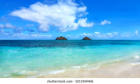 Laniaki beach in Oahu, Hawaii - perfect exotic holiday / vacation, blue turquoise sea with two little volcanic islands in the background