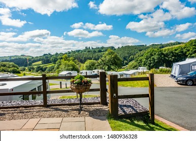 Lanidloes, Wales, UK – July 04 2019. Red Kite Campsite, Llanidloes, Wales. A campsite for touring caravans, motorhome and campervans exploring mid-Wales, UK