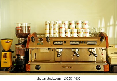 Lanjaron, Spain - Apr 14, 2014: Coffee maker, grinder and cups in a cafeteria.