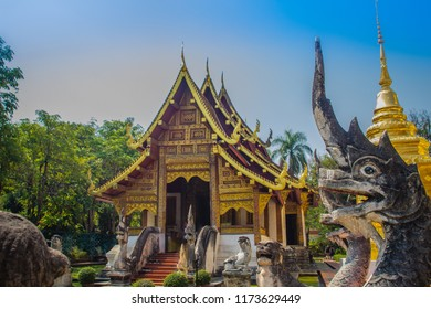 Lanna style Buddhist church at Wat Phra Singh(Temple of the Lion Buddha) with blue sky background. Wat Phra Singh is an important Buddhist monastery and temple on the west side of Chiang Mai, Thailand