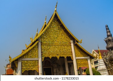 Lanna's style golden patterned background on the Buddhist church gable end. Thai golden pattern background crafted on the gable in the Buddhist temple with Lanna style at Wat Chedi Luang, Chiang Mai.