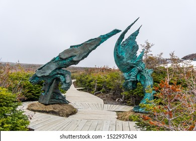 """L'anse aux Meadows, Newfoundland - 06/15/2019: Bronze sculpture, """"Meeting of Two Worlds"""" marks the meeting of human migration in Northern Newfoundland where the Vikings first landed in North America."""