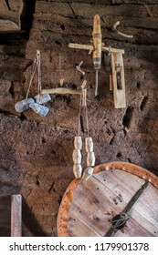 L'ANSE AUX MEADOWS, NEWFOUNDLAND/CANADA - AUGUST 1, 2018:  Viking tools hanging on wall of a reconstructed buildings at an archaeological site on the northernmost tip of the island of Newfoundland