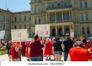 """Lansing, Michigan / United States - June 22, 2019: A pro-choice Abortion Ban Protest rally took place at the state capitol building. The protest took on a """"Handmaid's Tale"""" theme."""