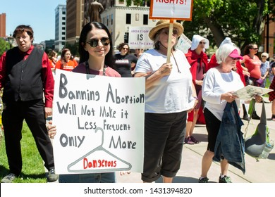 "Lansing, Michigan / United States - June 22, 2019: A pro-choice Abortion Ban Protest rally took place at the state capitol building. The protest took on a ""Handmaid's Tale"" theme."