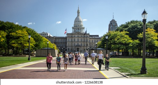 Lansing, Michigan, USA - September 9, 2018: Busy day at the Michigan state capitol building in downtown Lansing. The state capitol is offers free tours seven days a week.