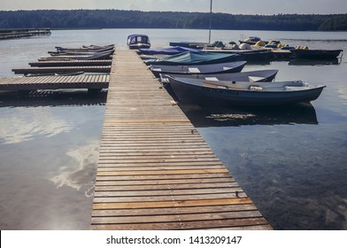 Lansk, Poland - August 16, 2010: Pier of Lansk Business & Holiday Resort over Lanskie Lake in Olsztyn Lake District, near the village of Lansk in Masuria region