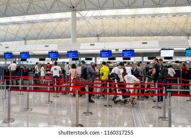 Lantau, Hong Kong  - August 05, 2018 : Airline passengers checking in at an airline counter at Hong Kong International Airport