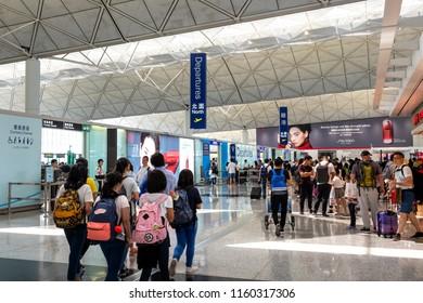 Lantau, Hong Kong  - August 05, 2018 :  Passengers carries luggage at Hong Kong International Airport