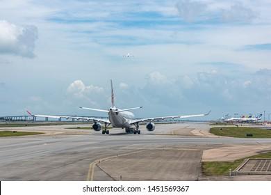 Lantau, Hong Kong  - June 22, 2018 :  Airplanes ready for take off at runway