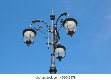 Lantern against blue sky