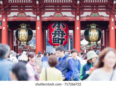 "lantern at Asakusa temple, Tokyo, Japan. japanese characters on red one is ""Hozomon"" mean ""treasure house gate"". japanese characters on two black one mean ""senjoji"" is another name of asakusa temple."