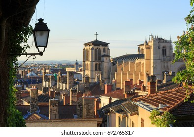 Lantern and cathedral St. Jean Baptiste in Vieux Lyon, the old town of Lyon, France. Focus on Lantern.