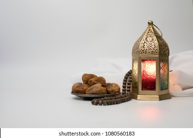 Lantern, Dates fruit and rosary beads photo for Ramadan and Eid greeting.