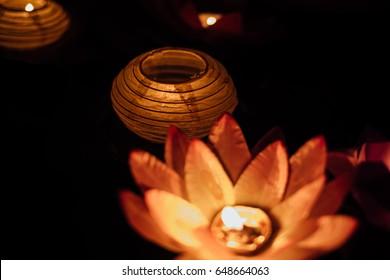 Lantern festival. Colorful lanterns on the water at night. light. chinese. ramadan. Lantern street. Lantern wedding. night. arabic. water.