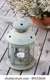 Lantern with heather on a wooden table