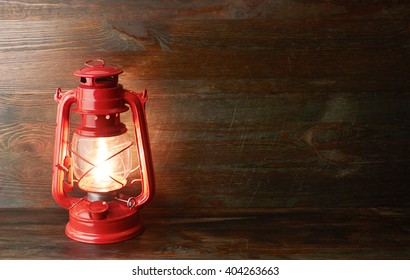 Lantern kerosene oil lamp, on wooden background