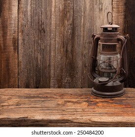 lantern lamp old wooden table wall background