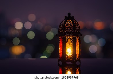 Lantern with night sky and city bokeh light background for the Muslim feast of the holy month of Ramadan Kareem. - Shutterstock ID 1931987969