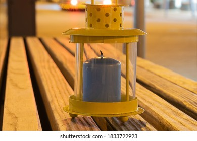 Lantern on a bench in the city at night