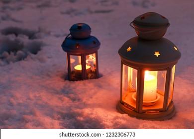Lantern on snow. Winter fairy tales.