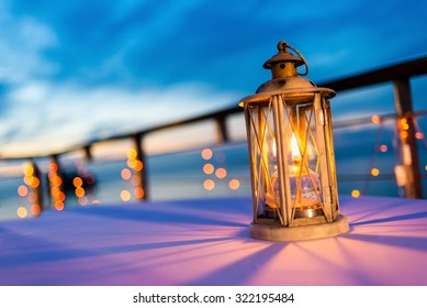 Lantern on table at twilight sky, selective focus.
